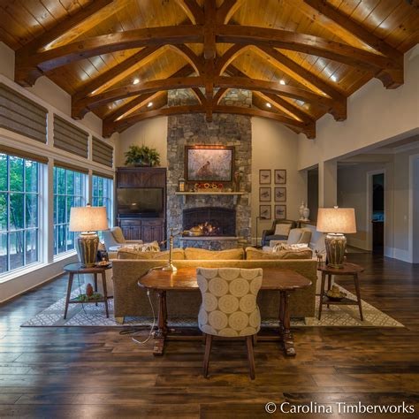 timber frame great room lighting photo of the day curved timber trusses carolina timberworks