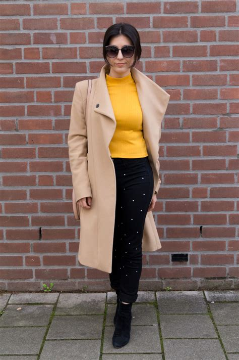 mustard top  black pearled jeans  colourful bouquet