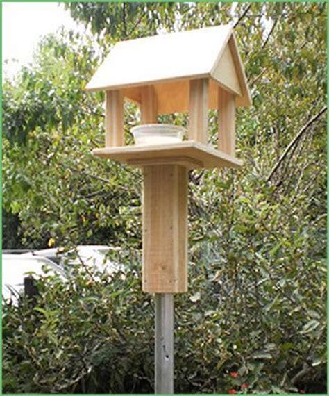 new zealand made pole mounted bird feeders roofed bird