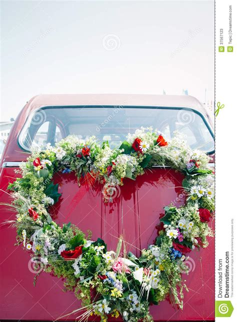 rear ended at a red bouquet on a red wedding car stock photos image 37567123