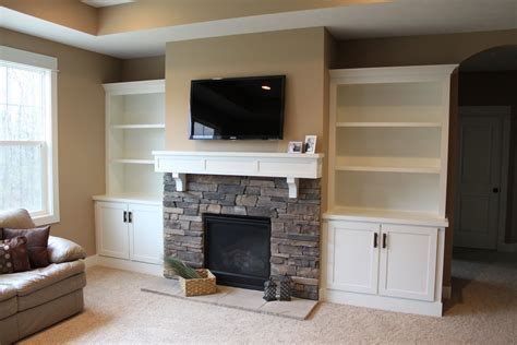fireplace with bookcases on each side pictures
