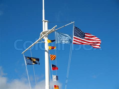 boat flying yellow flag nautical and american flags flying from a ship s mast with