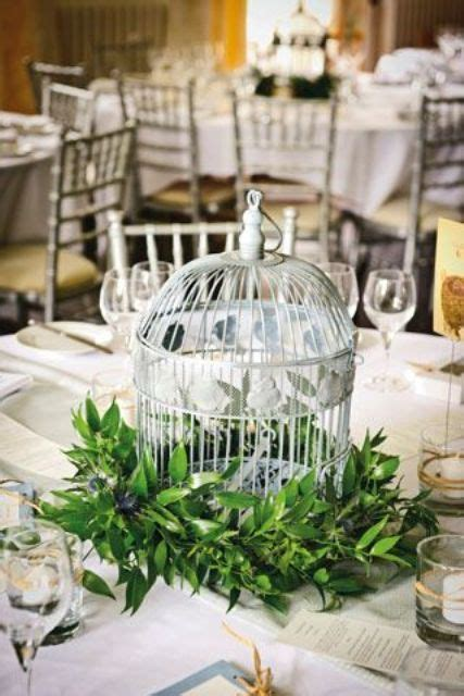 Picture Of A Birdcage Surrounded With Lush Foliage For A Birdcage Centerpieces Weddings