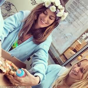 nicole trunfio and jessica hart eat pizza in blue onesies