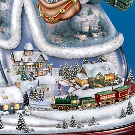 holiday memories lighted village and train music box kinkade let is snow snowman centerpiece at