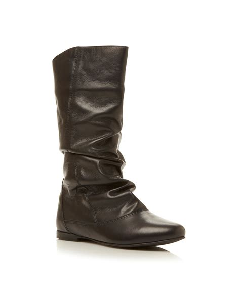 dune slouch calf boot in black lyst