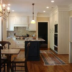 hide soffit above kitchen cabinets by adding crown molding small open plan kitchen living room design pictures