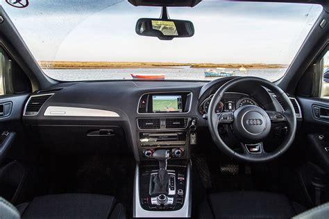 audi jeep interior land rover discovery sport vs audi q5 vs jeep vs