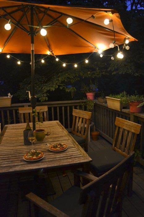 patio umbrella string lights 25 best ideas about outdoor umbrellas on deck