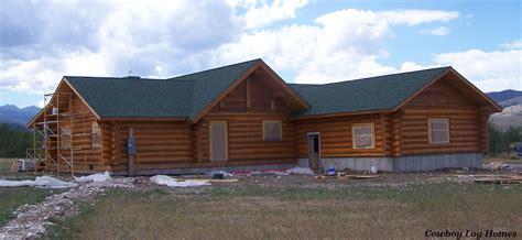 log home staining cowboy log homes