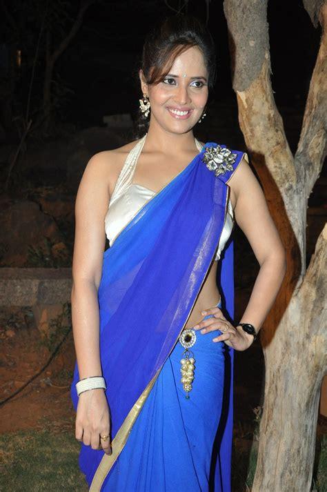 tv anchor anasuya latest hot blue saree images beautiful tv anchor anasuya latest hot blue saree images beautiful