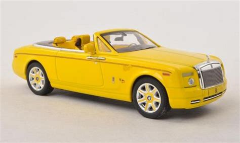 yellow rolls royce wraith rolls royce phantom drophead coupe bijan pakzad yellow ixo