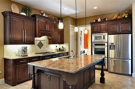 dark mahogany kitchen cabinets this kitchen by highland homes looks super love the dark
