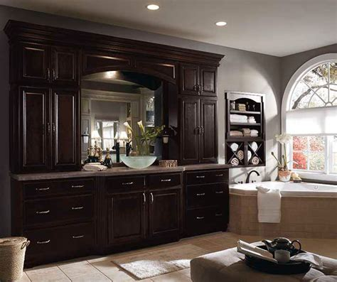 dark bathroom cabinets dark wood cabinets in traditional bathroom diamond