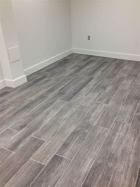 Grey Wood Tile Floor 25 best ideas about grey hardwood floors on