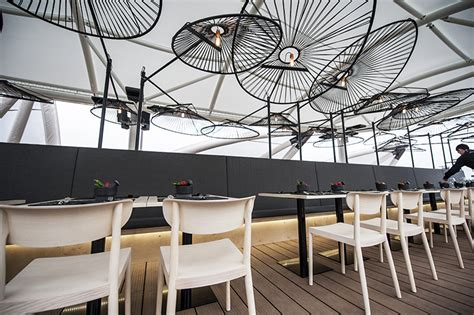 design library cafe milano via savona b 233 same mucho honors the acapulco chair in expo milan 2015