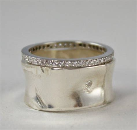 wide sterling silver band with small perfectly