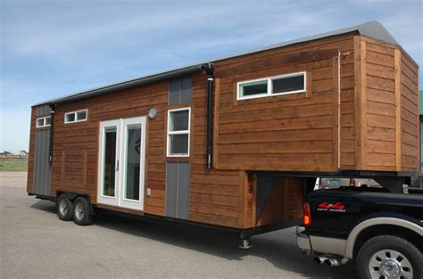 tiny house with slide out 34 gooseneck tiny house with 3 slide outs sold for 66k