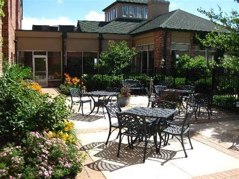 lush gardens surround our outdoor patio areas picture