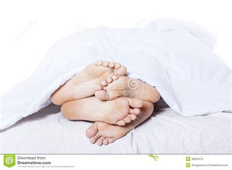 close up of feet cuddling in bed stock photo image 30562310