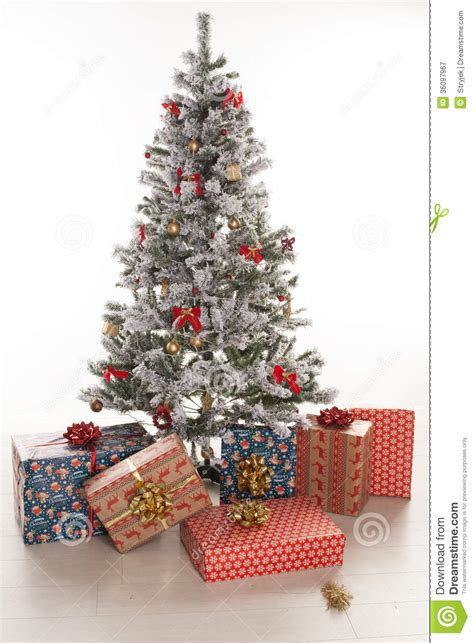 gift boxes wrapped under the christmas tree royalty free