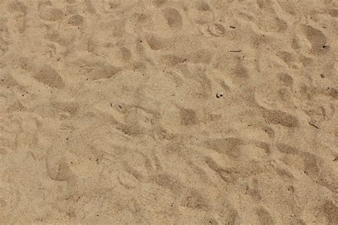 desk sand foot steps on sand 4241242 1600x1067 all for desktop