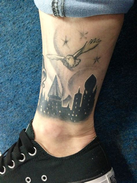 harry potter owl tattoo i like the hogwarts silhouette not on the leg though