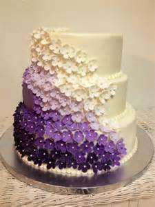 purple purple ombre marshmallow fondant flowers on this wedding cake with monogram red velvet
