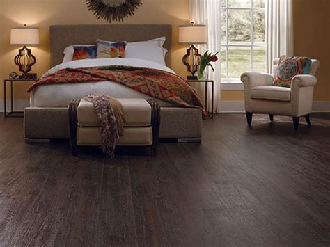 dark laminate flooring creates a warm and comfort feel in this bedroom laminate flooring