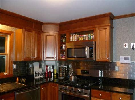 kitchen backsplash cherry cabinets black counter home design