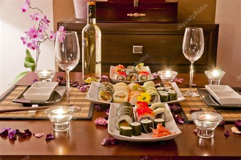 dinner at home sushi and wine stock photo