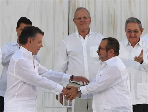 Guerrilla Signings by Colombia Signs Historic Peace Deal With Farc Rebels
