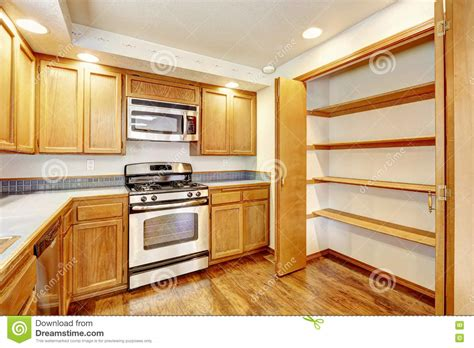 Flooring And Kitchen Cabinets For Less Kitchen With Golden Wood Cabinets And Hardwood Floor Stock Image Image Of American Building