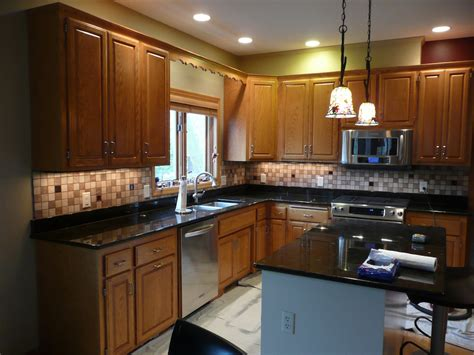 kitchen tile backsplash with colored glass accents inserts