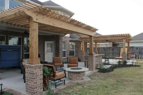 extended patio with brick border shade arbors firepit