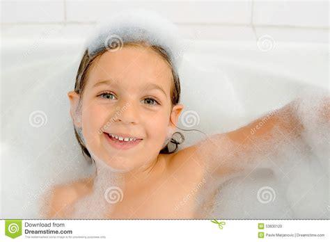Girl in a bathtub stock photo. Image of happy, cute, girl