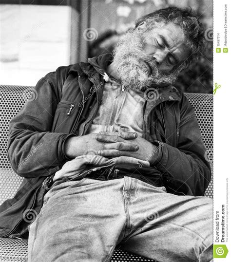homeless bench homeless guy sleeping on a bench editorial stock image image 15487314