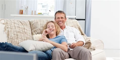 couple on sofa want a better marriage think twice about date nights