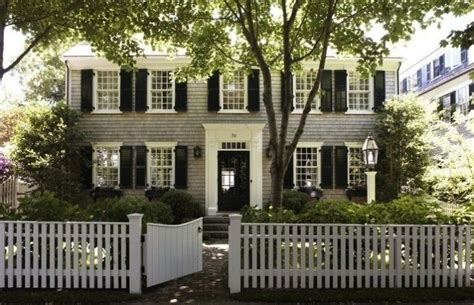 white colonial homes love white picket fences gray colonial house with black