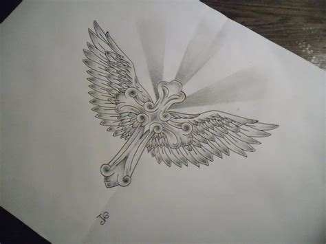 cross and sun tattoos this ia cross with wings i drew i used inspiration from