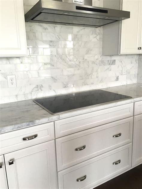 carrera marble subway tile backsplash  white cabinets kitchen ideas kitchen dining