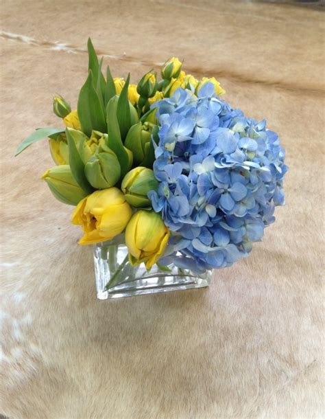 blue and yellow centerpieces yellow tulips and blue
