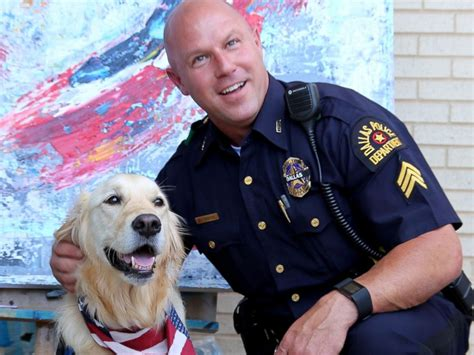 comfort officer comfort dogs travel to dallas to provide support to slain