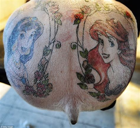 pigs tattooed with disney characters and louis vuitton