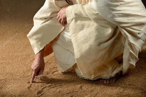 jesus writing won  sand stock photo  carlosphotos