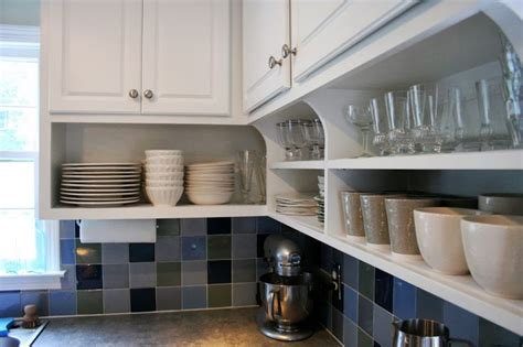 open shelves under cabinets raise your kitchen cabinets and add shelving underneath