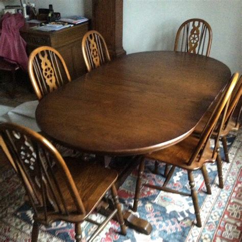 charm oval extending dining table and 6 chairs in