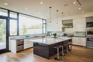 amazing Modern Pendant Lighting Kitchen #2: modern-kitchen-with-white-lacquer-cabinets-dark-wood-island-and-light-wood-flooring.jpg