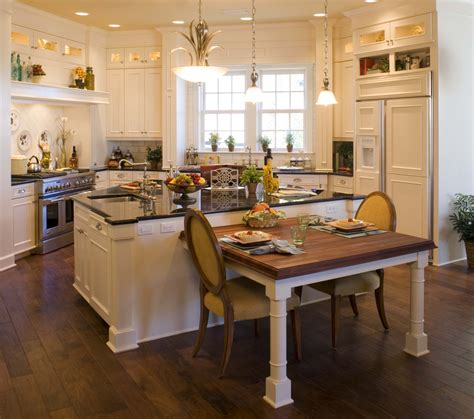 kitchen island with attached table peregrine homes designed this kitchen to an country feel with all white cabinets and