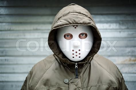 Masker Onstreet Maroon Spooky With Mask On The Stock Photo Colourbox